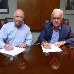 Signing the agreement is (left) APC Chairman Donald J Keehan, and (right) Peter Huni, President of HUNI + CO